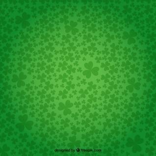 Shamrocks background in green color