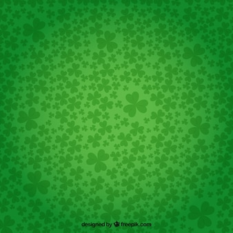 Shamrocks background in green color