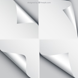 Sheets of paper with curled corners