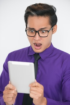 Shocked Asian Business Man Using Tablet