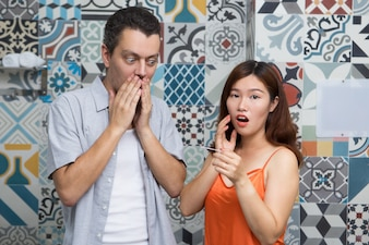Shocked couple knowing about pregnancy