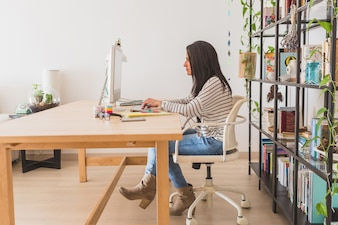 Side view of businesswoman working in the office