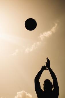 Silhouette of basketball player and ball