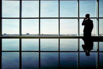 Silhouette of businessman enjoying the view