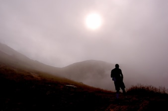 Silhouette of man on a foggy day