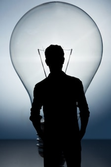 Silhouette of man with a light bulb