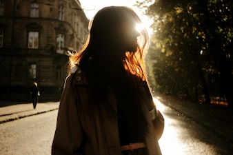 Silhouette of woman with sun behind