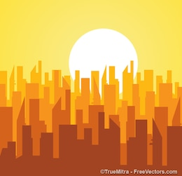 silhouettes of buildings at sunrise