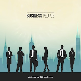 Silhouettes of people in a busy office