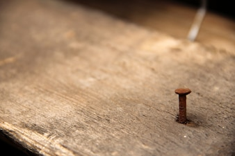 Single nail stuck in a wood