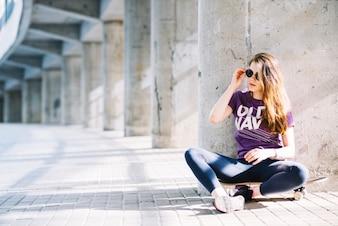 Skateboarder girl with sunglasses