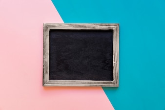 Slate on pink and blue background