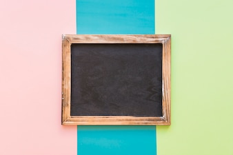 Slate with wooden border on colorful background