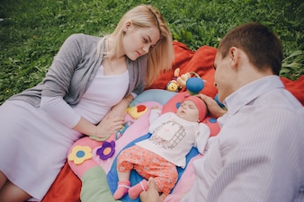 Sleeping baby with her parents looking