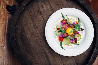 Sliced vegetables on white plate