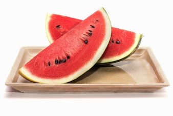 Slices of fresh watermelon isolated on white background