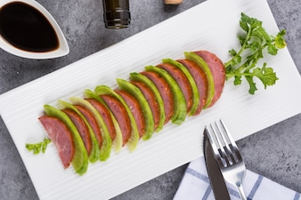 Slices of meat with some vegetables