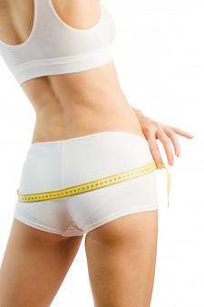 Slim woman with tape mesure