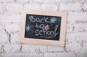 Small chalkboard saying Back to school