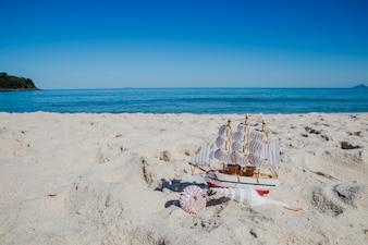 Small ship souvenir on sand