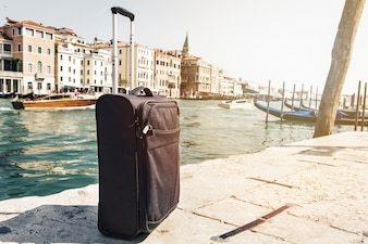 Small Suitcase on Travel Urban Background, Venice, Italy. Horizontal. Toning. Travel Vacation  Concept.
