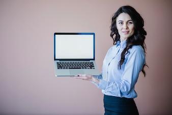 Smart business woman presenting laptop