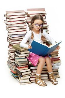 Smart girl sitting on many books