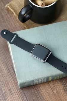 Smart watch and smartphone on the desktop