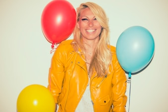 Smiley blonde posing with balloons