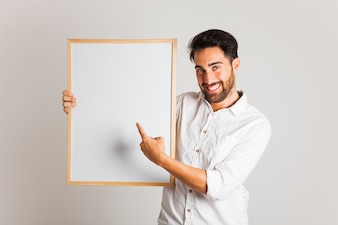 Smiley businessman pointing whiteboard