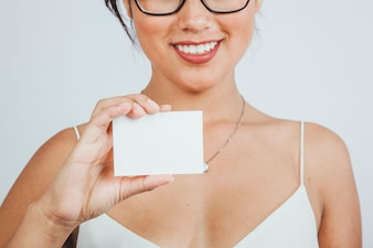 Smiley businesswoman showing business card