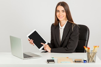 Smiley businesswoman working with tablet