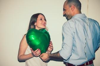 Smiley couple with a balloon