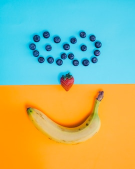 Smiley face composition with fruits