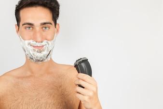 Smiley man shaving
