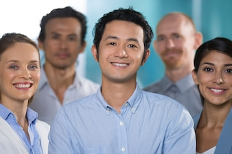 Smiling Asian man working with professionals