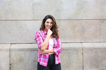 Smiling attractive girl in casual shirt outdoors