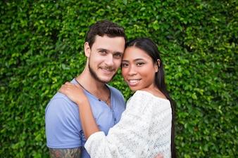 Smiling Attractive Interracial Couple Hugging