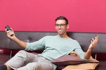 Smiling Attractive Man Enjoying Watching TV