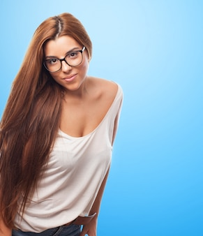 Smiling beautiful woman with long hair in glasses
