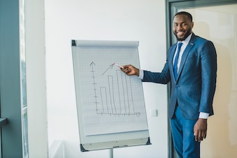 Smiling businessman showing chart
