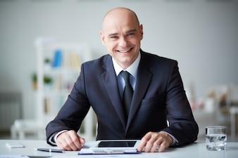 Smiling businessman with digital tablet