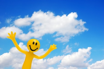 Smiling character with sky background