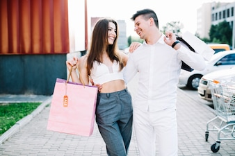 Smiling couple after shopping
