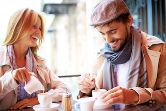 Smiling couple having a coffee