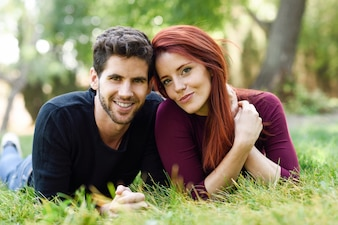 Smiling couple lying on the lawn