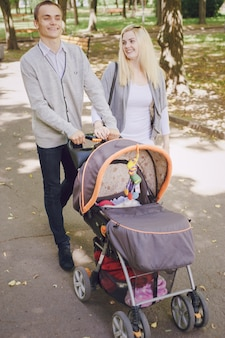 Smiling couple walking their baby