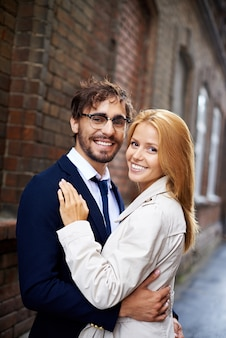 Smiling embracing couple
