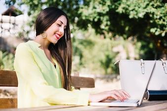 Smiling girl at laptop