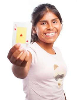 Smiling girl holding a poker card